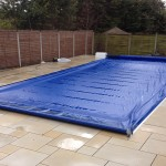 Finished pool with coverstar safety cover fitted and closed