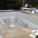 Swimming pool walls fibreglassed.