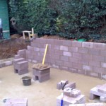 Concrete blocks being laid for pond walls