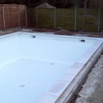 Swimming pool with new skimmers,sumps and copings fitted, and walls and floor fibreglassed.